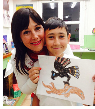 SOS BC Ambassador Eleni with an SOS Child from Greece