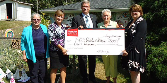 Vancity Cheque Presentation at the Village